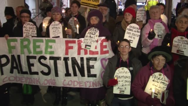 members of jews united against zionism and members of code pink protest outside the washington convention center where the american israel public... - jahreshauptversammlung stock-videos und b-roll-filmmaterial