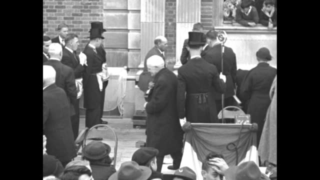 stockvideo's en b-roll-footage met members of local freemason lodge wearing small aprons around their waists and top hats stand by as cornerstone is placed into the new silver spring... - hogehoed