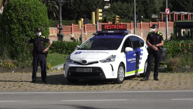members of metropolitan barcelona police are seen with their car informative control while people exercise outdoor on may 02, 2020 in barcelona,... - police car stock videos & royalty-free footage