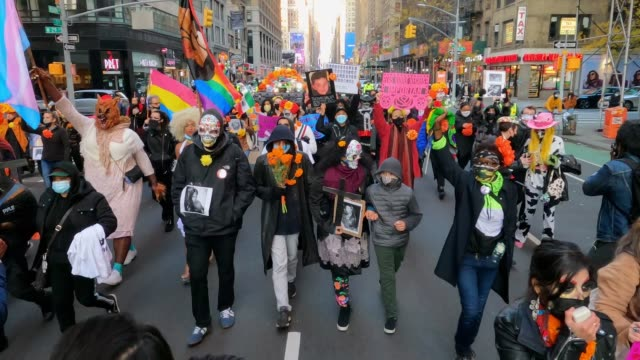 members of mexicanos unidos and black lives matter supporters celebrate dia de los muertos with a march through the streets of manhattan to... - dia stock videos & royalty-free footage