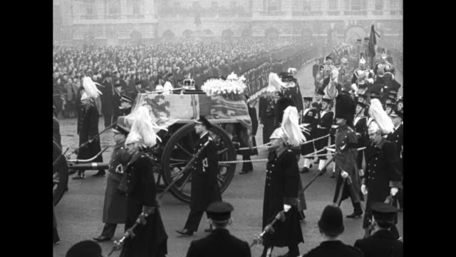 members of military march in formation along street saluting / caisson with coffin of king atop it is pulled along street by formation of sailors... - royal navy stock videos and b-roll footage