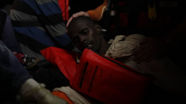 members of moas and the red cross try to keep a man alive, who it was believed was suffering after breathing fumes from a boat engine he was... - rescue stock videos & royalty-free footage