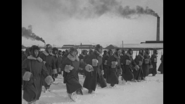 vs members of national police reserve marching in formation through snow / three shots of members of reserve running in formation through snow /... - 朝鮮戦争点の映像素材/bロール