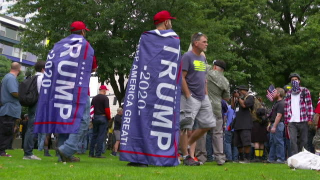 members of neofascist and white supremacist groups wearing trump paraphenalia at rally in portland oregon - portland oregon video stock e b–roll