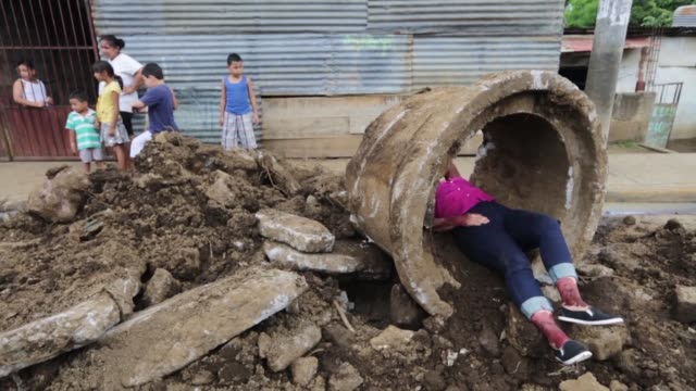 members of nicaragua's national system of prevention care and disaster mitigation take part in a natural disaster drill with residents of the reparto... - managua stock videos & royalty-free footage