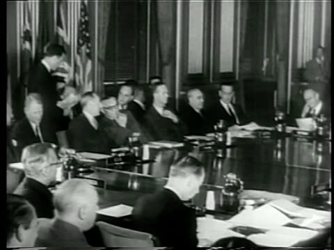 members of north atlantic council seated at large table in meeting / documentary - 1949 bildbanksvideor och videomaterial från bakom kulisserna