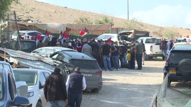 members of palestinian fatah movement and palestine liberation organisation gather with residents of khan al-ahmar to protest against israeli... - palestine liberation organisation stock videos & royalty-free footage
