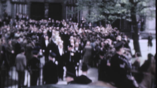 members of parliament walking through crowd lined streets on ve day after leaving westminster abbey / london england united kingdom - ve day stock-videos und b-roll-filmmaterial