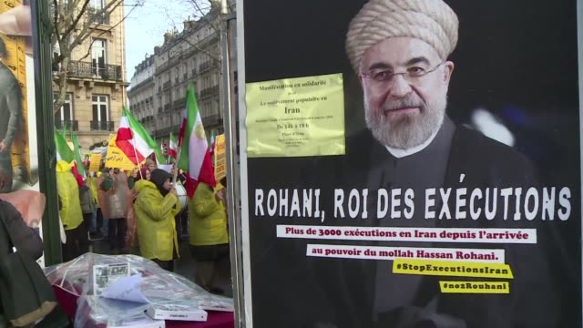 Members of People's Mujahedeen an Iranian opposition movement in exile that has been battling the Tehran government since the 1960s gather in Paris