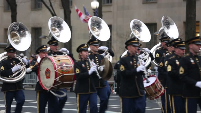 Members of Pershing's Own marching band perform on Pennsylvania Avenue while participating in Donald Trump's inaugural parade January 20 2017 in...