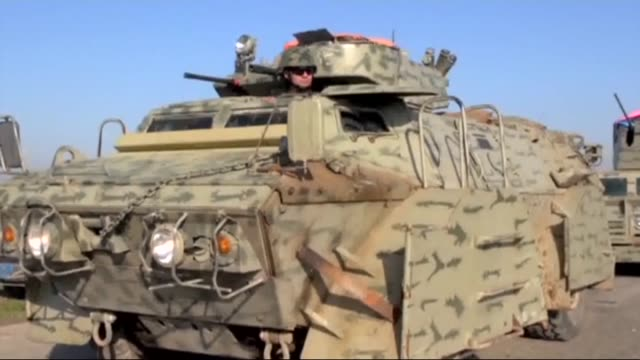 members of peshmerga forces launch attacks against islamic state of iraq and levant in the northern parts of mosul to recapture the areas occupied by... - isil konflikt stock-videos und b-roll-filmmaterial