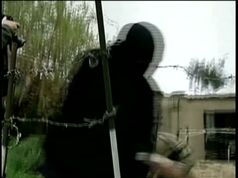 members of radical islamist group fatah alislam based in northern lebanon running through barbed wire on assault course/ ms la man jumping over... - terrorism stock videos & royalty-free footage
