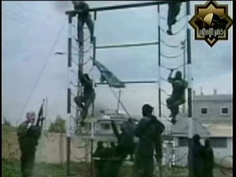 ws members of radical islamist group fatah alislam based in northern lebanon training outdoors on climbing frame/ lebanon - terrorism stock videos & royalty-free footage