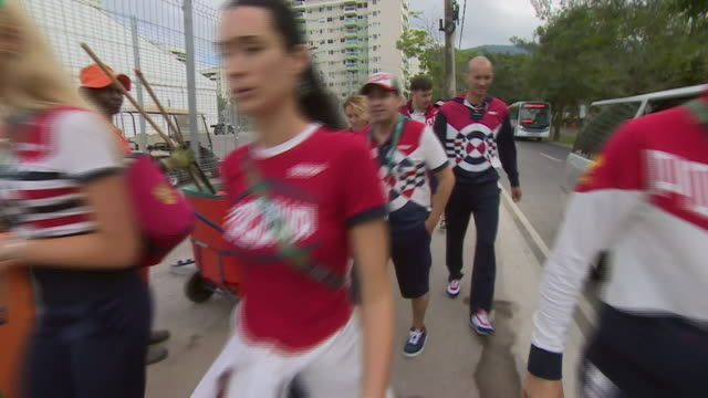 members of russia's olympic squad arriving at rio's olympic park for their accreditation despite not being sure they'll be allowed to compete due to... - ドーピング点の映像素材/bロール