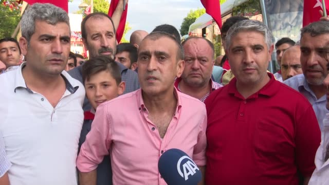 members of seyrantepetopkapi minibus unit gather to protest against parallel state/gulenist terrorist organization's failed military coup attempt in... - staatsstreich stock-videos und b-roll-filmmaterial