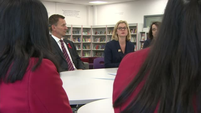 Members of Social Mobility Commission resign over lack of progress Various shots Justine Greening MP and Jeremy Hunt MP seated in school with children