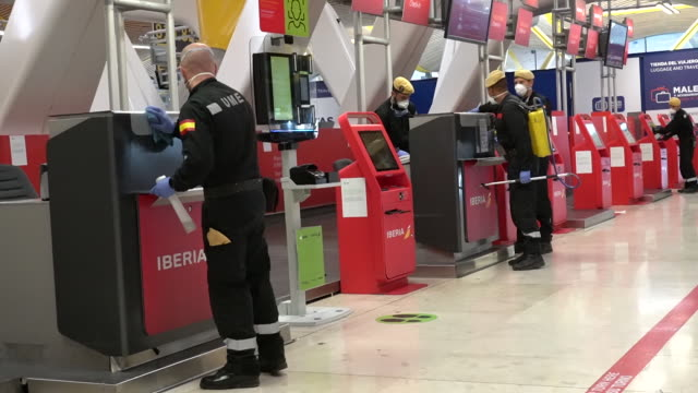 members of spain's military emergencies unit clean at madrid barajas airport, operated by aena sa, in madrid, spain, on thursday, march 19, 2020. the... - ticket stock videos & royalty-free footage