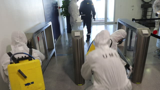 members of spain's military emergencies unit during a deep clean operation at the border inspection point at the port of barcelona in barcelona,... - examining stock videos & royalty-free footage
