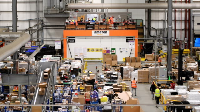 Members of staff process purchased items in the Amazon Fulfilment centre on November 15 2017 in Peterborough England A report in the US has suggested...