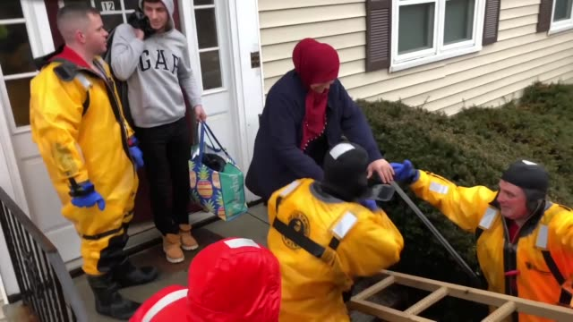 members of the 125th quartermaster company massachusetts army national guard assist the quincy fire department in high water rescue operations 200... - national guard stock videos and b-roll footage