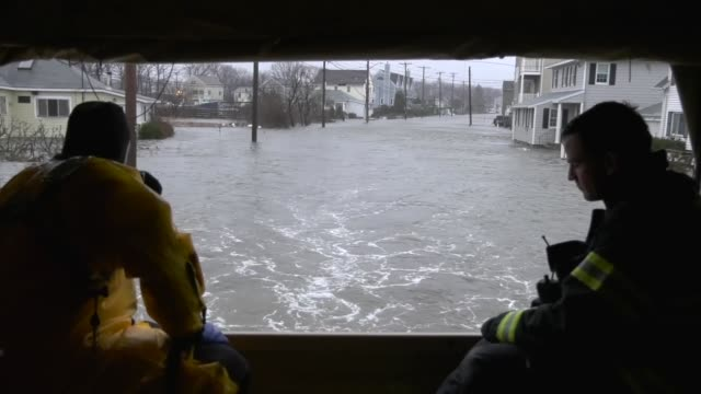 members of the 125th quartermaster company massachusetts army national guard assist the quincy fire department in high water rescue operations 200... - fire engine stock videos & royalty-free footage