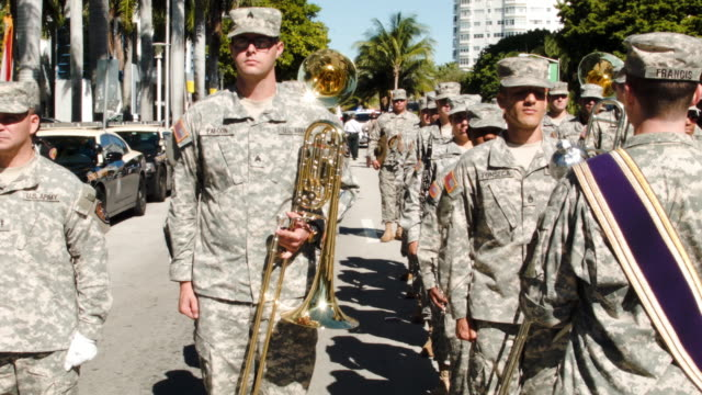 members of the 13th army band, florida army national guard, take part in the parade at the miami beach veterans day ceremony on november 11, 2014 in... - veterans day stock videos & royalty-free footage