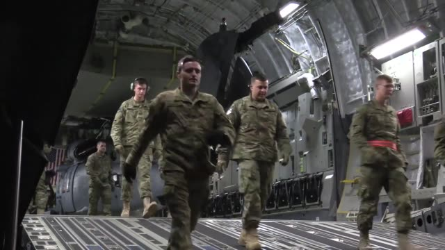 Members of the 33rd Expeditionary Rescue Squadron offload supplies and an HH60G Pave Hawk helicopter from a C17 Globemaster III at Kandahar Airfield...