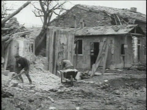 members of the 34th engineers, 79th division going through rubble of ruins with shovels, hammering, filling wheelbarrow - 1918 stock videos & royalty-free footage