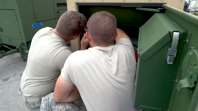 members of the 36th civil engineer squadron assigned to andersen air force base guam set up and maintain a clean water supply for residents in need... - guam stock videos and b-roll footage