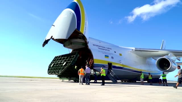 members of the 36th mobility response squadron assigned to andersen air force base, guam, unload building materials from a russian antonov an-124... - guam video stock e b–roll