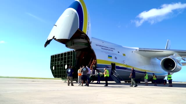 members of the 36th mobility response squadron assigned to andersen air force base guam unload building materials from a russian antonov an124 cargo... - guam stock videos and b-roll footage