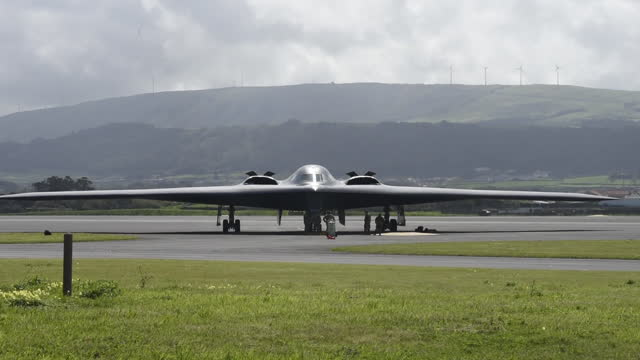 members of the 393rd expeditionary bomb squadron perform a hot-pit refuel with three b-2 spirit stealth bombers as part of a bomber task force at... - tail stock videos & royalty-free footage