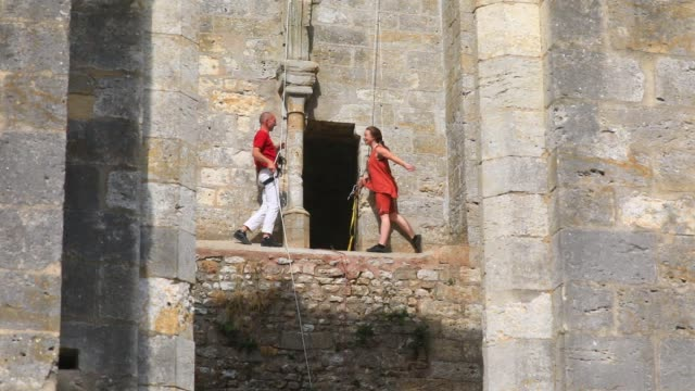 """members of the aerial dance company """"in fine"""" perform a choreography on a wall of the ruined nave of the """"saint-mathurin church on september 20, 2020... - modern dancing stock videos & royalty-free footage"""
