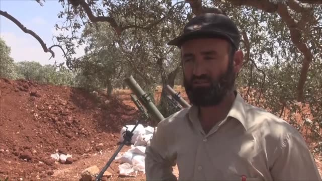 members of the ahrar ash-sham which belongs to the opponent al-fatah forces load artillery with a howitzer before attacking syrian regime-controlled... - howitzer stock videos & royalty-free footage