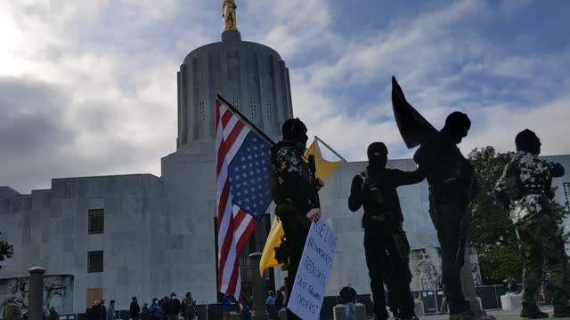 members of the anti-government group, the boogaloo boys, protest on january 17, 2021 in salem, oregon. protesters gathered at state capitol buildings... - oregon us state stock videos & royalty-free footage