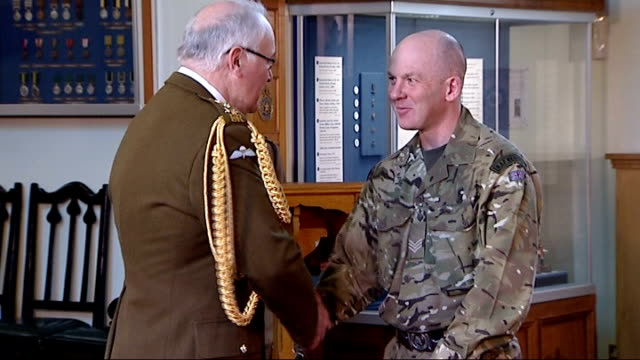 118 members of the armed forces receive bravery awards england int sergeant roy geddes who was awarded the military cross for helping to repulse a... - military attack stock videos and b-roll footage