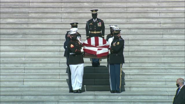 members of the armed services carry the american flag draped casket of late georgia congressman john lewis down the east front steps to a hearse for... - 正装安置点の映像素材/bロール