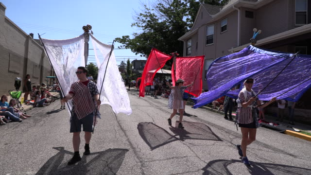 Members of the Arts Alliance of Greater Bloomington participate in the Bloomington 4th of July parade July 4 2019 in Bloomington Ind