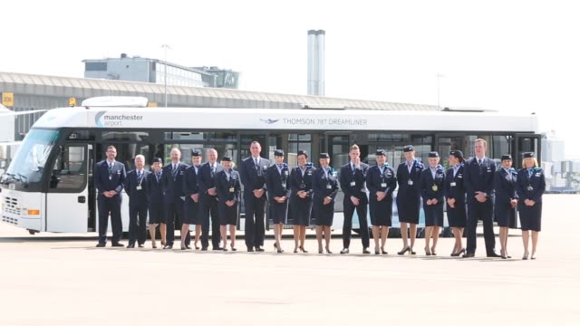 members of the cabin crew pose in a line in from of a thomson 787 dreamliner bus at manchester airport chris browne managing director of uk and... - boeing 787 stock videos and b-roll footage
