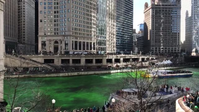 members of the chicago journeyman plumber's union used a special environmentally safe dye to turn the chicago river emerald green for st patrick's... - river green stock videos & royalty-free footage