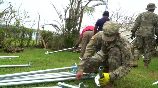 members of the commonwealth of northern marianas islands department of fire and emergency services and the 797th engineer company army reserve guam... - guam stock videos and b-roll footage