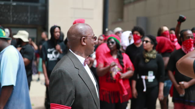 members of the dayton chapter of the black panthers make black power fists. hundreds of counter protesters, including the nation of islam, new black... - dayton ohio stock videos & royalty-free footage