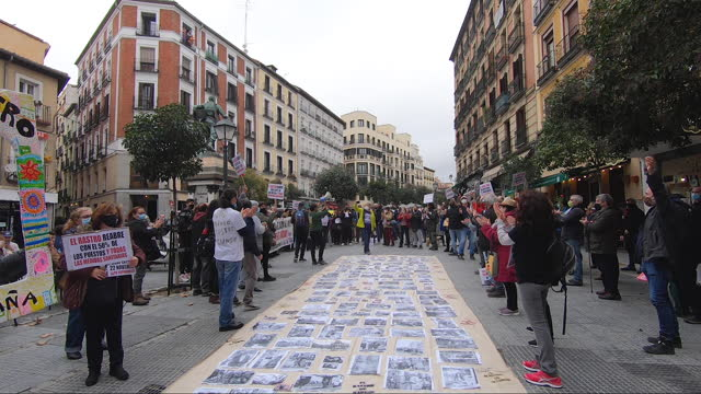 members of the el rastro association of street vendors hold a huge banner with historic pictures of el rastro during a protest on the streets on... - flea market stock videos & royalty-free footage