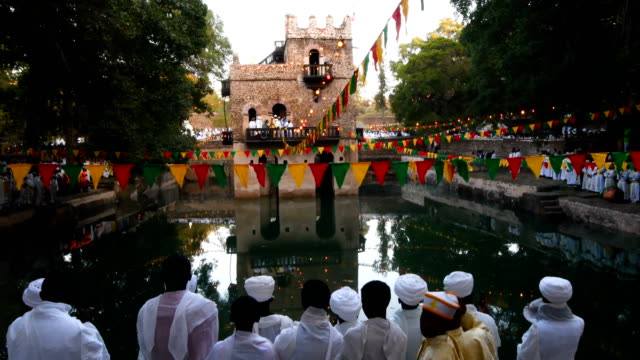 members of the ethiopian orthodox clergy attend mass at fasilides bath during the annual timkat epiphany celebration on january 19 2017 in gondar... - clergy stock videos & royalty-free footage