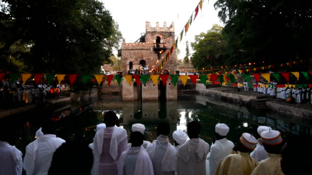 members of the ethiopian orthodox clergy attend mass at fasilides bath during the annual timkat epiphany celebration on january 19 2017 in gondar... - gondar stock videos and b-roll footage