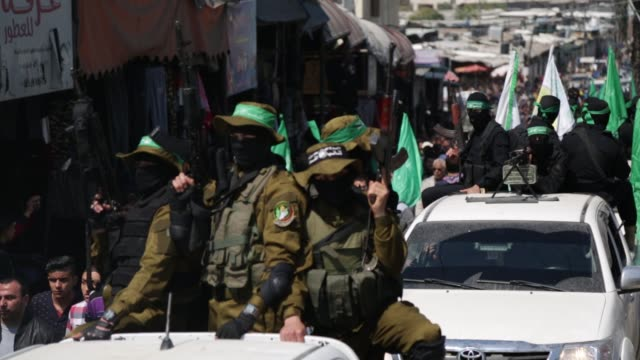 members of the ezzedine alqassam brigades the military wing of the palestinian islamist movement hamas carry the body of hamas official mazen faqha... - hamas stock videos & royalty-free footage