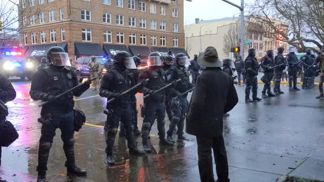 members of the far-right face off with police during a protest against covid-19 restrictions at the state capitol on january 1, 2021 in salem,... - salem oregon stock videos & royalty-free footage