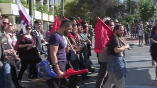 members of the greek communist party affiliated group the all workers militant front marched to syntagma square in athens as part of a general strike... - links platz stock-videos und b-roll-filmmaterial
