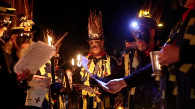 members of the hook eagle morris dancers in the vaughan millennium apple orchard during a 'wassail' in hartley wintney hampshire - orchard stock videos & royalty-free footage