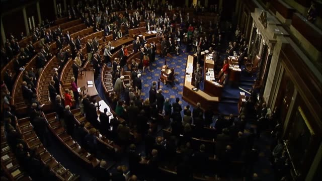 members of the house of representatives pause in remembrance of the victims of the november 13 terrorist attacks in paris, france. - アメリカ連邦議会点の映像素材/bロール